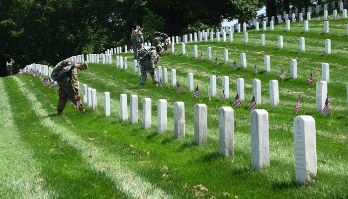 The 3rd US Infantry Regiment, known as The Old Guard, has placed American Flags at grave sites for service members buried at Arlington National Cemetery and the US Soldiers' and Airmens' Home prior to Memorial Day weekend. (Source: CNN)