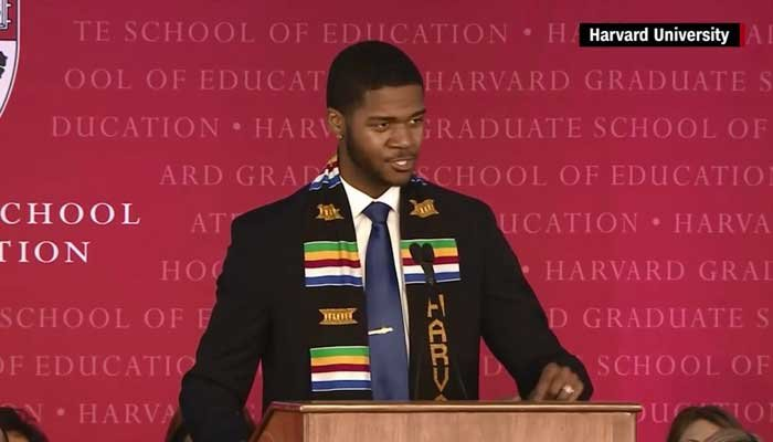 Harvard grad Donovan Livingston delivered a convocation speech in spoken-word poetry. (Source: Harvard University/CNN)