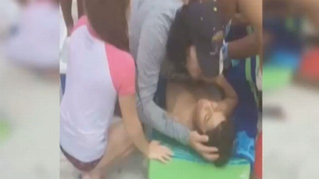 RAW: Witness describes bloody shark bite scene