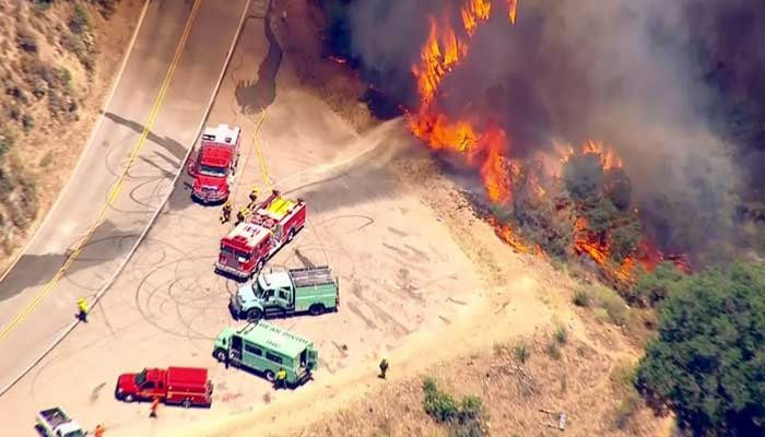 Sweeping evacuations are underway as firefighters battle four massive wildfires in Southern California. (Source: KCAL/KCBS/CNN)