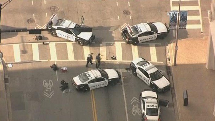 Dallas police watch over the scene Friday where five officers were killed and seven others wounded by gunfire during a protest. (Source: KTVT/CNN)