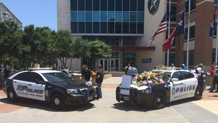 Two Dallas Police Department squad cars sit Friday outside headquarters as a memorial for the five slain officers. (Source: Dallas PD/Twitter/CNN)
