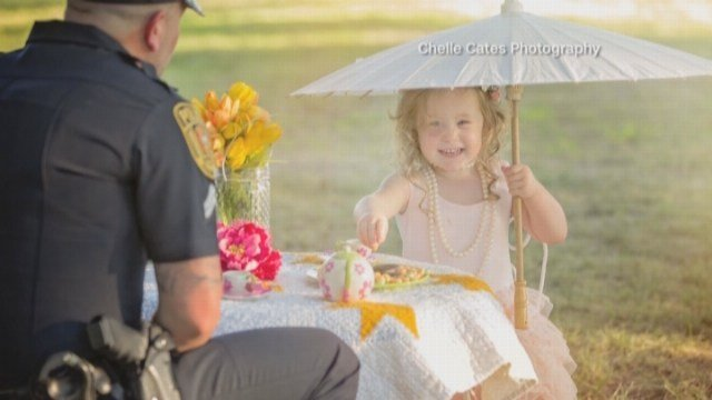 Officer has tea party with girl whose life he saved