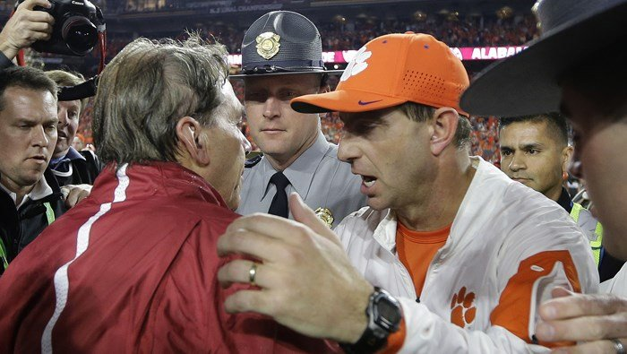 Nick Saban and Dabo Swinney speak after the 2016 national title game. Alabama plays Southern Cal and Clemson plays Auburn as the season gets underway. (Source: AP/David J. Phillip)