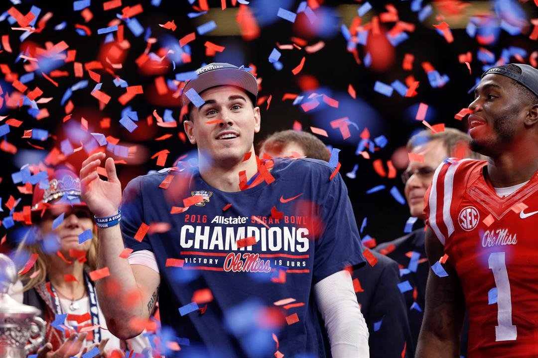Ole Miss quarterback Chad Kelly grins in bemusement while Laquon Treadwell looks on after the Rebels beat Oklahoma State in the 2016 Sugar Bowl. (Source: AP/Bill Feig)