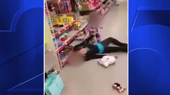 Cell phone video shows a toddler pulling at her mother's limp body after the woman apparently overdosed. (Source: Lawrence police/WFXT/CNN)
