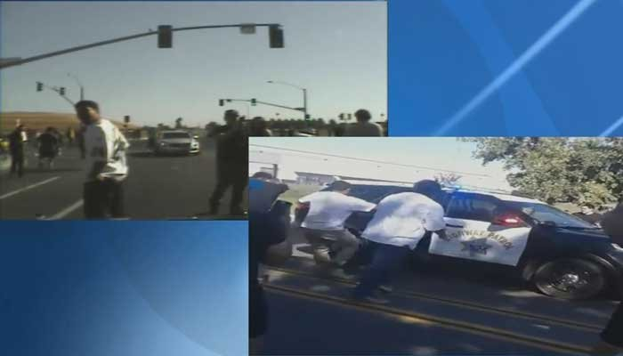 New dash cam footage shows crowd attacking police vehicle in CA