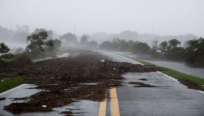 Debris litters a road after it washed over from Hurricane Matthew on St. Simons Island, Ga. (Source: AP Photo/David Goldman)