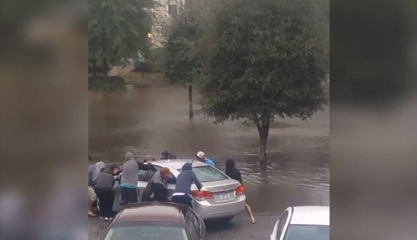 A car is pulled from the flood caused by Hurricane Matthew in Walterboro, SC. (Source: Kat Anderson via CNN)