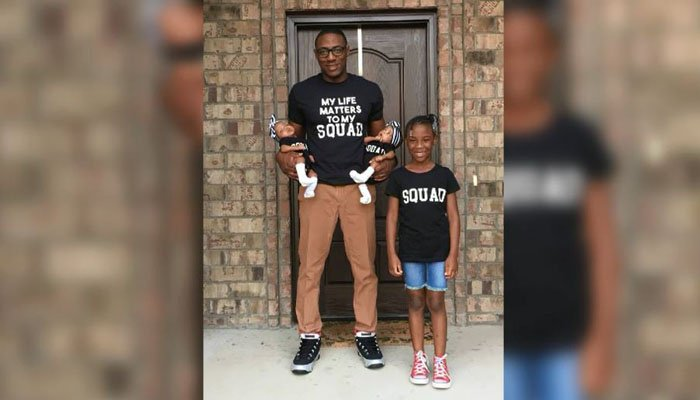 A husband and father hopes a viral photo of his shirt inspired by the Black Lives Matter movement will inspire discussion of racism in the U.S. (Source: Roy Family/CNN)