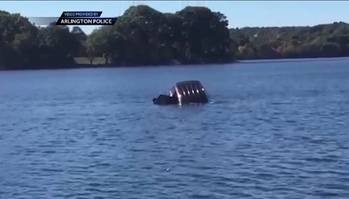 A man is speaking out after saving a woman from an SUV that was sinking in a pond. (Source: WCVB/Arlington Police Department/CNN)
