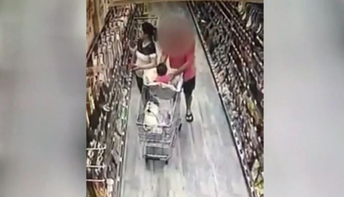 The man wasn't able to get the baby fully out of the cart, but the case is being investigated as a possible attempted abduction. (Source: H-Mart/KTRK/CNN)