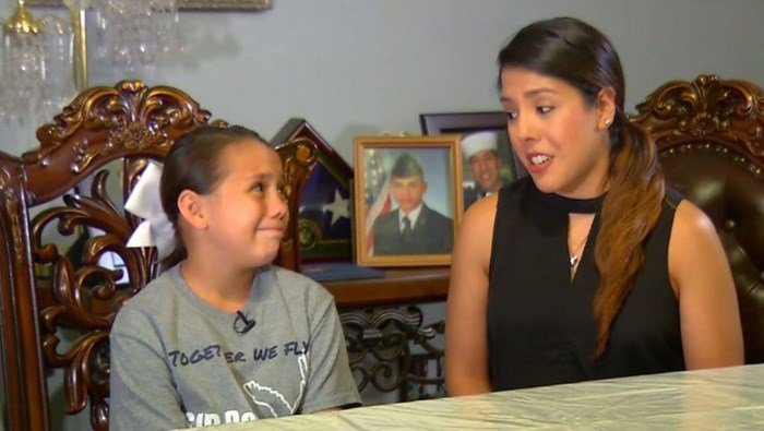 Addie Rodriguez missed her airman dad very much while on the field at a San Antonio, TX, high school. She is a cheerleader and was performing when every other dad lifted their girls onto their shoulders. (Source: KABB/WOAI/CNN)