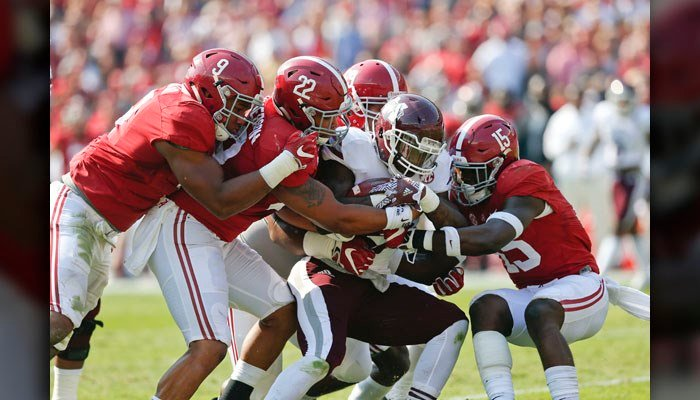 The Alabama defensive line does that thing it does to a Mississippi State running back earlier this season. (Source: AP/Brynn Anderson)