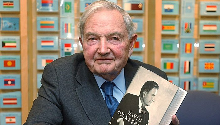 David Rockefeller Sr. poses with his book, Memoirs, during a book signing party on Dec. 17, 2002, at the United Nations book shop in New York. (AP Photo/Suzanne Plunkett)