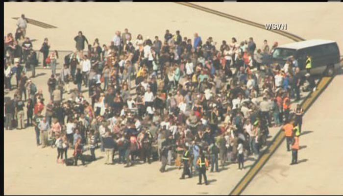 A large group of people seen evacuating the Fort Lauderdale, FL, airport. (Source:  WSVN)