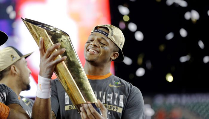 Clemson's Deshaun Watson holds up the championship trophy after the college football playoff championship game against Alabama on Jan. 10, in Tampa. Clemson won 35-31. (Source: AP Photo/David J. Phillip)