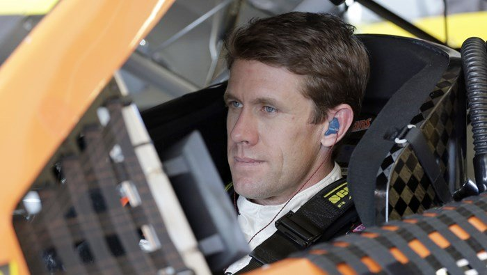 Carl Edwards sits in his car preparing for NASCAR racing practice at Homestead, FL, on Nov. 18, 2016. (Source: AP/Terry Renna)