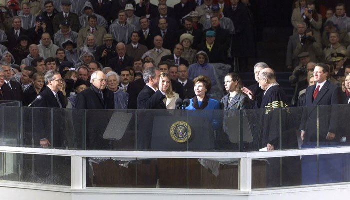 George W. Bush is sworn in as the 43rd president outside the U.S. Capitol in Washington on Jan. 20, 2001. Al Gore, far right,  watches.  (Source: AP Photo/Ron Edmonds)