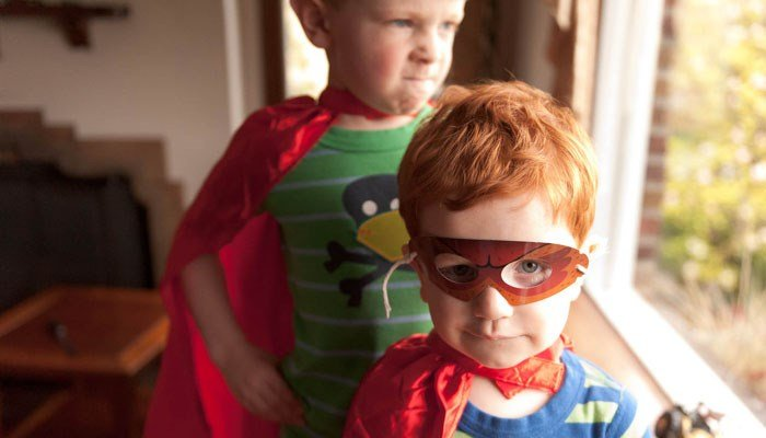 Children pick up on aggressive themes of superhero media rather than moral or social messages, according to a new study. (Source: Brian Dewey/Flickr)