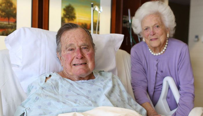 In this photo provided by the Office of George H.W. Bush on Monday Jan. 23, former President George H.W. Bush and his wife Barbara pose for a photo at Houston Methodist Hospital in Houston. (Source: Courtesy the Office of George H.W. Bush via AP)
