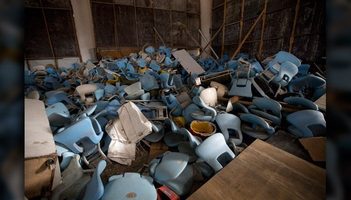 This Feb. 2 photo shows seats jumbled in a pile inside Maracana stadium in Rio de Janeiro, Brazil.  (AP Photo/Silvia Izquierdo)
