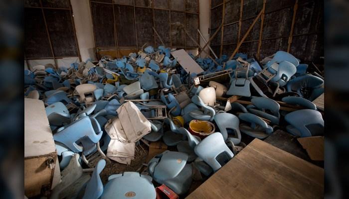 This Feb. 2 photo shows seats jumbled in a pile inside Maracana stadium in Rio de Janeiro, Brazil.  (AP Photo/Silvia Izquierdo)