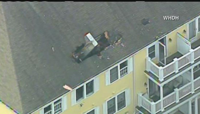 Pilot dies after small plane crashes into MA apartment building