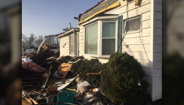 Homes and buildings in southern IL were extensively damaged. In Crossville, IL, one man died. Tom McCord was found 40 yards from his home, authorities report. (Source: @hillary14News/Twitter)