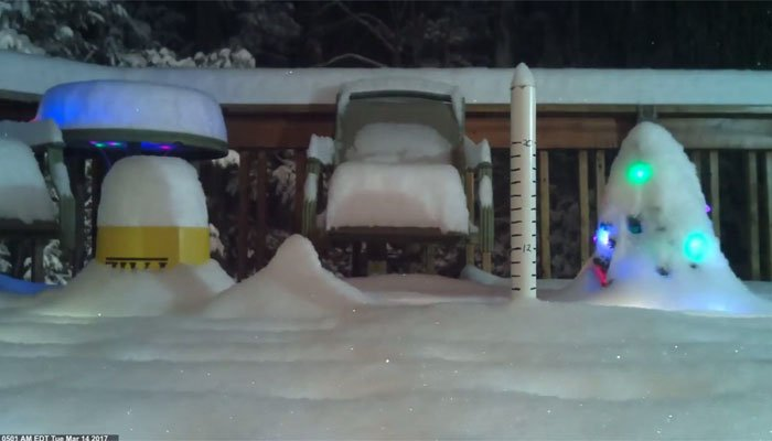 A New York resident's porch becomes enveloped in snow after only a few hours. (Source: Ron Murphy/CNN)