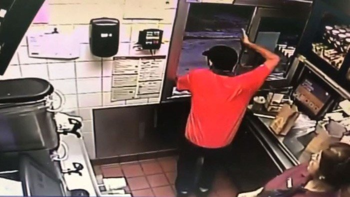 Florida McDonald's employee jumps through drive-thru window to save officer