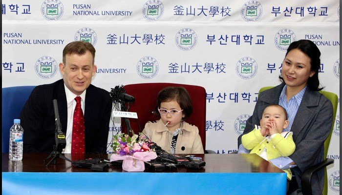 Robert Kelly, left, a political science professor at Pusan National University, holds a press conference with his wife Jung-a Kim, right, and children James and Marion at the university in Busan, South Korea, Wednesday. (Ha Kyung-min/Newsis via AP)