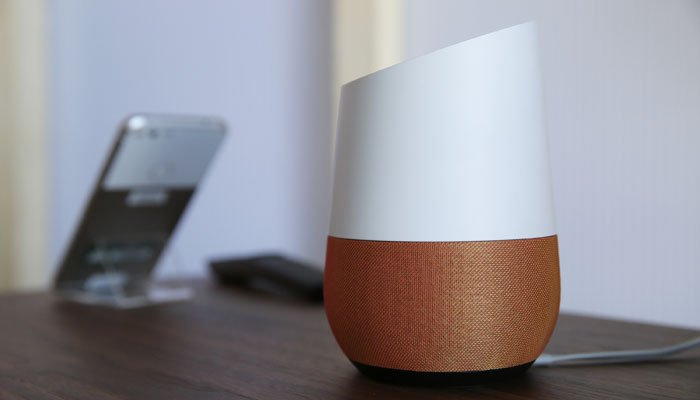 Google's smart speaker is treading in new territory: playing ads. (AP Photo/Eric Risberg)