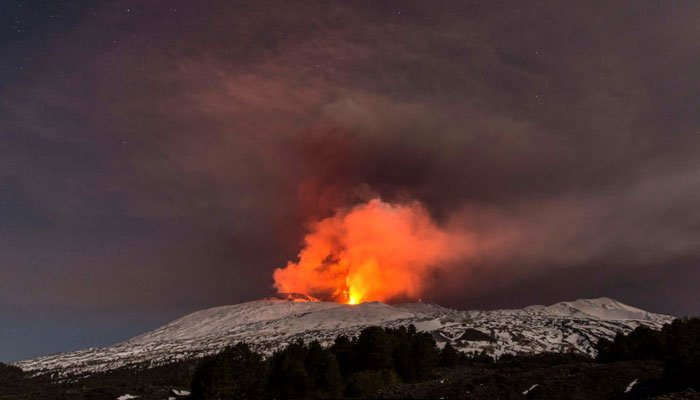 Snow-covered Mount Etna, Europe's most active volcano, spews lava during an eruption in the early hours of Thursday, March 16, 2017.  (Source: AP photo/Salvatore Allegra)