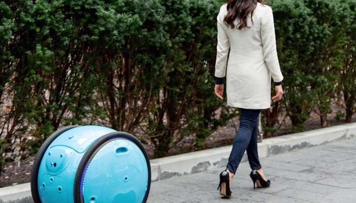 The new Gita robot is designed to schlep your groceries and other shopping items behind you, in style. It's set for production next year. (Source Piagio Fast Forward/CNN)