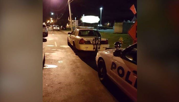Police cars and yellow tape can be seen near the nightclub and around the parking area. (Source: Cincinnati Police Dept.)