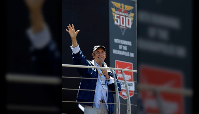"Jim Nabors waves  after singing ""Back Home Again in Indiana"" for the final time before the start of the 98th  Indianapolis auto race at the Indianapolis Motor Speedway on May 25, 2014. (Source: AP/Michael Conroy)"