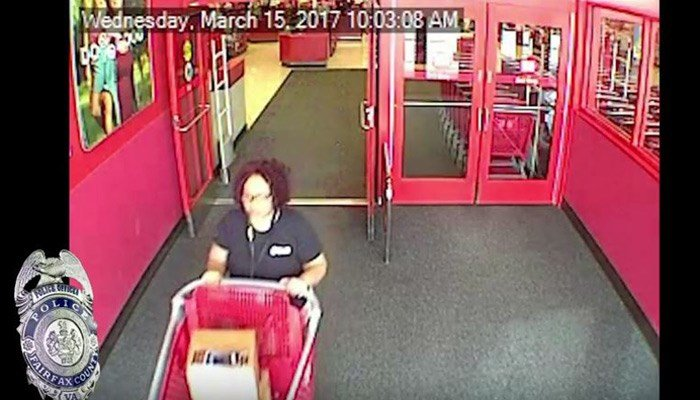 She put more than $40,000 worth of iPhones in a box. She is seen in surveillance video leaving the store. (Source: Fairfax County PD/YouTube)