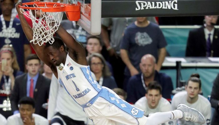 North Carolina's Theo Pinson (1) dunks during the first half in the finals of the Final Four NCAA college basketball tournament against Gonzaga, Monday, April 3, 2017, in Glendale, Ariz. (AP Photo/Matt York)