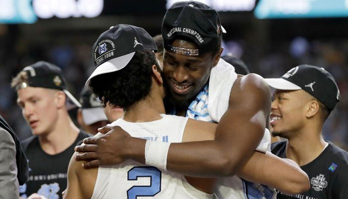 North Carolina's Joel Berry II (2) and Theo Pinson celebrate after the Final Four NCAA college basketball tournament against Gonzaga, Monday, April 3, 2017, in Glendale. North Carolina won 71-65.  (Source: AP Photo/David J. Phillip)