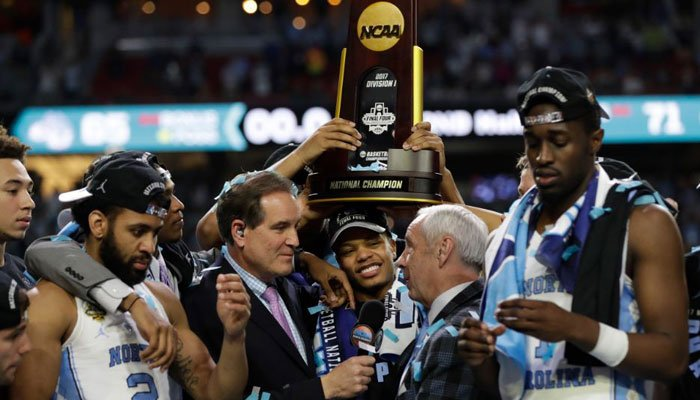 North Carolina head coach Roy Williams us interviewed as he celebrates with his team after the finals of the Final Four NCAA college basketball tournament against Gonzaga, Monday, April 3, 2017, in Glendale, Ariz. North Carolina won 71-65.  (Source: AP Ph