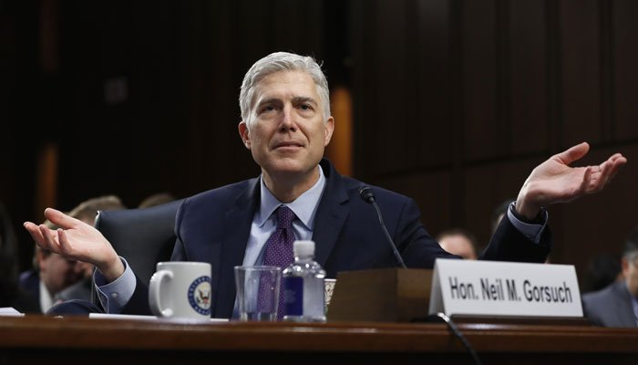 Supreme Court Justice nominee Neil Gorsuch gestures as he testifies on Capitol Hill in Washington, Tuesday, March 21, 2017, at his confirmation hearing before the Senate Judiciary Committee. (AP Photo/Pablo Martinez Monsivais)