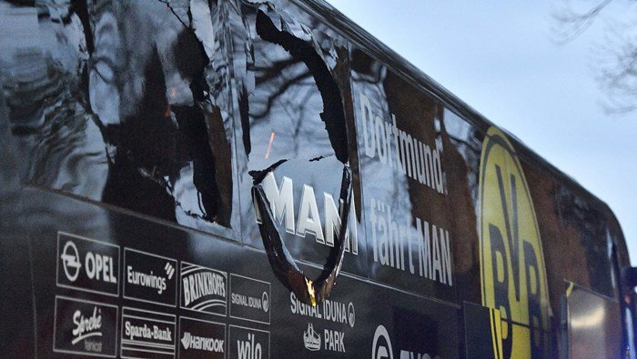 A window of Dormund's team bus shows damage after mysterious explosions before the team's game with Monaco on Tuesday night in Western Germany. (Source: AP/Martin Meissner)