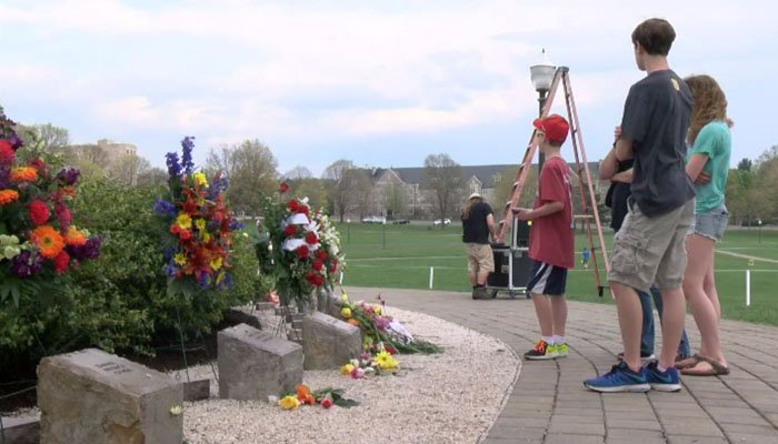 Flowers lie at the memorial for the students who were killed 10 years ago. (Source: WDBJ via CNN)