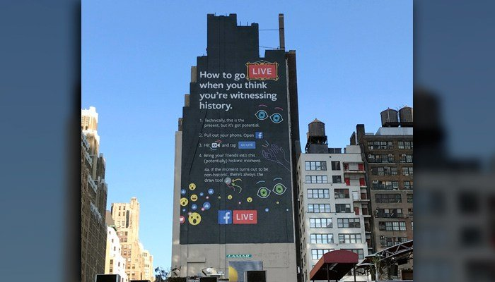 This Nov. 16, 2016, photo shows a Facebook Live billboard on the side of a building near New York's Penn Station. Aside from history, Facebook users have taped crimes live. (AP Photo/Anick Jesdanun)