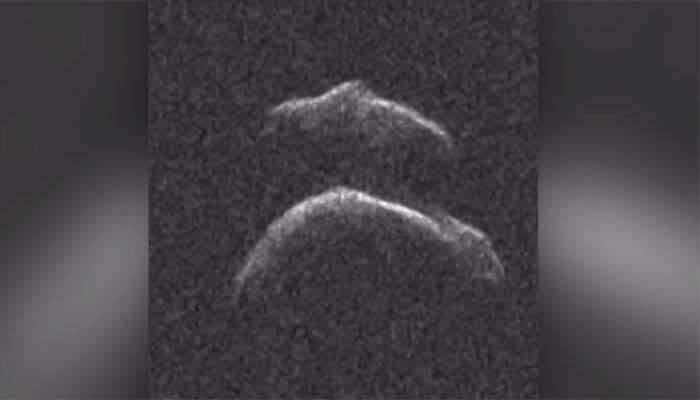 This asteroid will pass by Earth this week. It's roughly the size of six football fields. (Source: CNN)