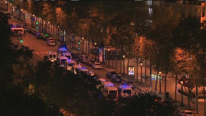 French police gather at the Champs Elysee in Paris. One officer is dead in a shooting. (Source: CNN)