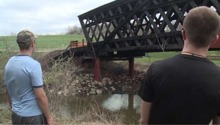 Two teens facing arson charges for burning one of the famed Madison County bridges were seen on a newscast visiting the scene the day after the fire. (Source: WHO-DT/CNN)
