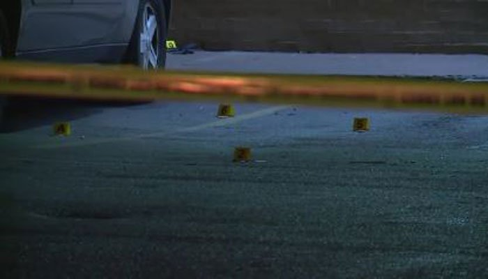 Police place markers where shell casings litter the ground on Monday in St. Louis. (Source: KTVI/CNN)