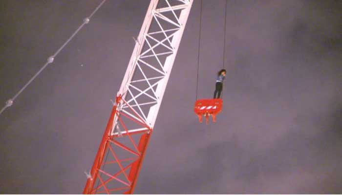 Woman on crane: How and why she got there are mysteries